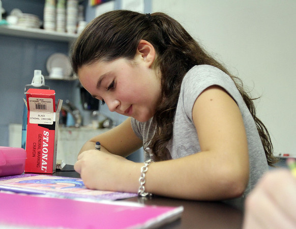Lexi Samora, a 5th grader at the Marblehead Community Charter Public School works on a piece of artwork in preparation for their Exhibition on Wednesday afternoon. David Le/Salem News