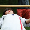 Beverly: Ieuan Higgins, 11, barely sqeezes himself under the limbo bar during a field day for campers at the Artworks at Waring summer camp program on Friday afternoon. Photo by David Le/Salem News