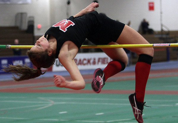 Marblehead high jumper Kelly Roland leaps over the bar at the NEC Conference Meet at Reggie Lewis Center on Thursday. David Le/Salem News
