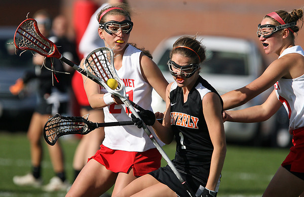 Beverly's Hayley Lewis (1) center, looks to spin away from Masco defenders Kathleen Gillespie, left, and Amy Arnold, right, on Friday afternoon. David Le/Staff Photo