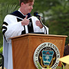 Dr. Michael Lescault gives a thumbs up to the Bishop Fenwick Class of 2012 during his invocation speech on Friday evening.  David Le/Staff Photo