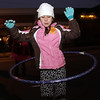 Beverly: Alexa Medina, 6, of Danvers, hula hoops in the middle of Cabot St. on New Year's Eve. David Le/Salem News