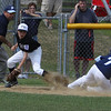Danvers: Beverly West thirdbaseman Matt Townsend is just a bit late in applying the tag to Peabody National thirdbaseman Anthony Hartnett who slides safely into third. Beverly and Peabody kicked off their all-star tournaments with their game on Saturday morning in Danvers. Photo by David Le/Salem News