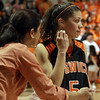 Ipswich freshman Masey Zegarowski (5) talks with her mother and Ipswich Head Coach Mandy Zegarowski during a timeout. David Le/Staff Photo