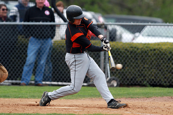 Beverly's Alex Toomey lines a base hit against Danvers on Thursday afternoon. David Le/Staff Photo