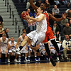 Danvers junior captain Eric Martin draws contact as he goes in for a layup. David Le/Staff Photo