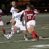 Peabody's Victoria Digiacomo passes to a teammate around an East Longmeadow defender on Friday night. David Le/Salem News
