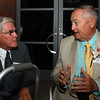 Tom Leonard, right, talks with Moe Morency, left, at a dinner hosted by the Essex National Hertiage Commission and the National Park Service in Leonard's honor. David Le/Staff Photo