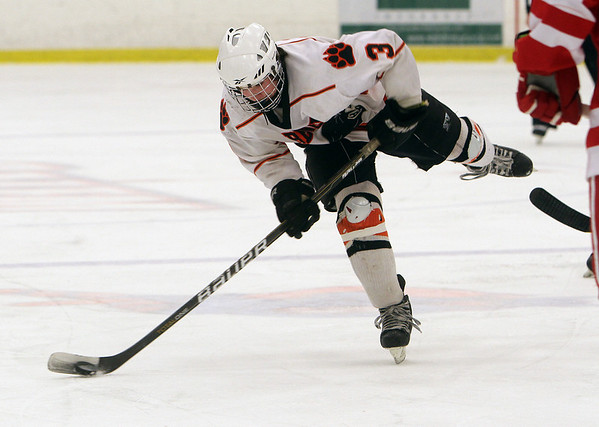 Beverly's Kevin Lally rips a shot on net against Saugus. David Le/Staff Photo