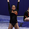 Beverly's Taylor Metta, swings on the bars during her routine on Friday night. David Le/Salem News