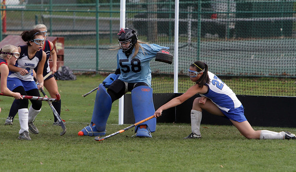 Danvers goalie Gabi Torchia (58) kicks away a shot by a Lincoln-Sudbury player during their game on Thursday afternoon with the assistance of Lindsay Gotts (27). David Le/Salem News