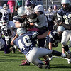 Hamilton-Wenham linebacker Pete Duval (40) tries to bring down Bourne High School running back Marquesse Rhodes (24). David Le/Salem News