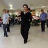 Tina LaFlam, of Gloucester, leads seniors at the Danvers Senior Center, in line dancing on Wednesday afternoon. David Le/Salem News