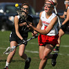 Masco's Amy Arnold (21) right, gathers a loose ball while being pursued by Beverly's Katie Pietrini (17) left, on Friday afternoon. David Le/Staff Photo