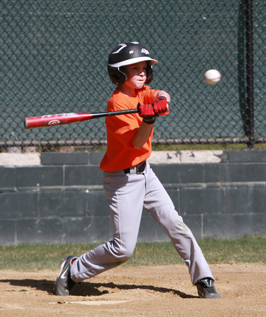Ryan Dumball, 11, a member of the major league Tigers in Marblehead Youth Baseball takes a swing during a scrimmage against the Braves on Tuesday afternoon. David Le/Staff Photo