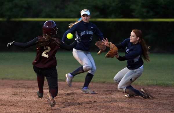 Swampscott second baseman Kelly Birchmore keeps her eyes on the ball as she races to beat Newburyport runner Jackie Krusemark to the base. David Le/Staff Photo