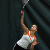 Ipswich High School first doubles player Megan Freiberger smashes a serve over the net against Bedford in the D3 North Finals at Bass River Tennis Club in Beverly on Friday afternoon.  David Le/Staff Photo