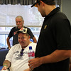 Peabody: Bill Lake, center, plays Wii bowling against a few Boston Bruins players on Friday afternoon while Bill Pickard, left, and Bruins forward prospect Craig Cunningham watch. Bruins players visited the Pilgrim Rehabilitation Center in Peabody on Friday afternoon to play Wii games, air hockey, and bingo with 30 of the patients. Photo by David Le/Salem News