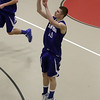 Danvers guard Nick Bates (15) rises up and drains a 3-point shot. David Le/Salem News