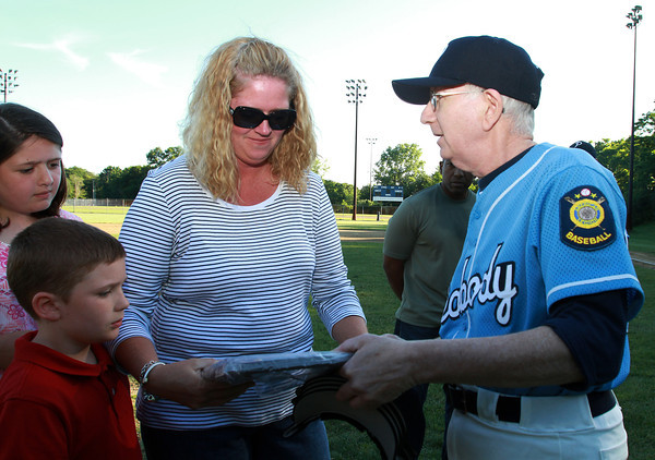 Peabody Legion Baseball coach Lou Karger, right, presents Amy Rice, wife of fallen firefighter Jim Rice, with the Peabody Legion 1986 League Championship plaque on Thursday afternoon. David Le/Staff Photo