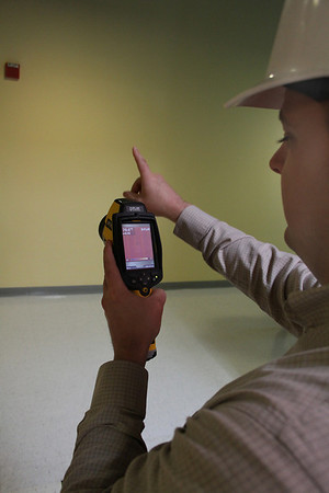 Salem: Chris Henson, Founder and President of Joe Green Home Solutions, takes a reading from his infrared camera, which he uses for energy audits,  at the Enterprise Center at Salem State College on Friday morning. Photo by David Le/Salem News
