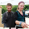 Charlie Hatch, of Beverly, and Ashley Craig, of Cambridge, look through soap varieties at the Beverly Farms SoapWerks tent at the Beverly Farmer's Market on Monday afternoon. David Le/Staff Photo