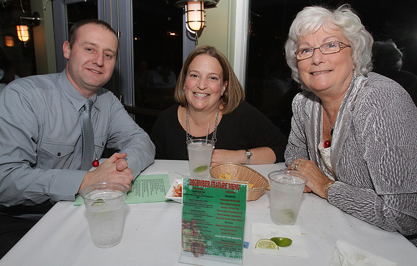 Salem: From left, Justin and Amy Muzarol, and Carol Potvin, at Salem's Annual Christmas Charity Fundraiser held at Victoria's Station on Tuesday evening. David Le/Salem News
