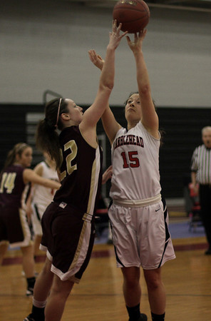 Marblehead's Lindsey Cohen (15) gets her shot blocked by Gloucester'sAudrey Knowlton (22) left. David Le/Salem News