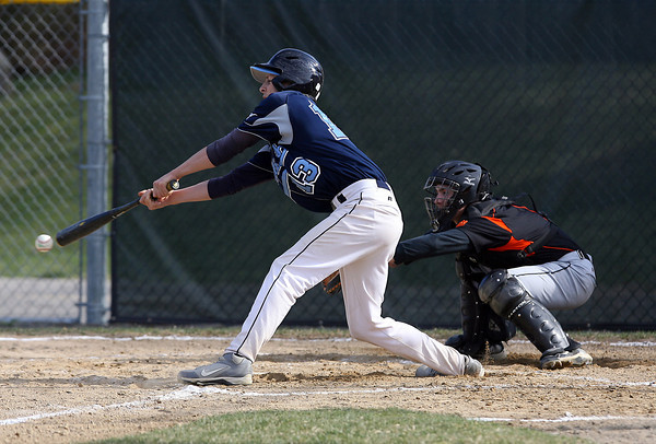 Peabody's Steve Leavitt reaches out and pokes a base hit into the outfield against Beverly. David Le/Staff Photo