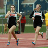 Beverly sophomores Nicole Demars, left, and Mary Cate Flaherty, right, run through a light drizzle during the 800 on Tuesday afternoon. David Le/Staff Photo