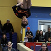 Beverly's Heather Gomes flips upside-down during her routine on Friday night. David Le/Salem News