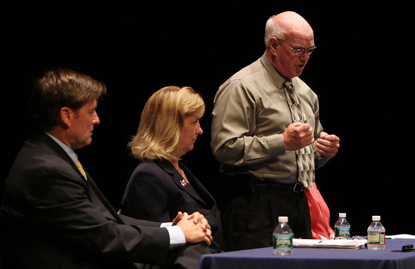 State Senate candidate Edward Carroll, provides a rebuttal to a statement made by fellow candidate Joan Lovely, second from left, while Lovely and candidates John Slattery, left, and Mary-Ellen Manning, far right, listen. David Le/Staff Photo