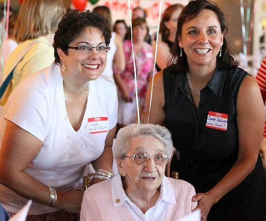 Danvers: Aquilina Bucci, center, is surrounded by two of her granddaughters, Joyce Frisiello, left, and Joanne DeLorenzo, who organized Ms. Bucci's 100th birthday party at the Danversport Yacht Club in Danvers for family and friends on Saturday afternoon. Photo by David Le/Salem News