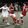 Peabody's Hayley Dowd carries the ball and beats two East Longmeadow defenders on Friday night. David Le/Salem News