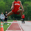 Salem senior Figgy Cruz soars through the air during the long jump against Beverly on Tuesday. David Le/Staff Photo