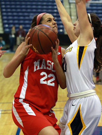 Masco junior Claudia Marsh (22) left, goes up strong to the hoop against Andover's Devon Caveney (10 right, during the D1 North Final at the Tsongas Center on Saturday. David Le/Staff Photo