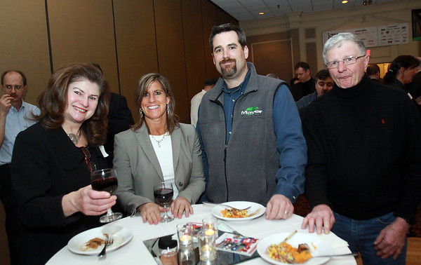 From left, Karen Pinelli and Rhonda Craig of Paychex, Jeff Bourque, of Mayer Tree Service, and Joseph Grillo, of JNG Associates, at the North Shore Chamber Business Expo held at the Sheraton Ferncroft. David Le/Staff Photo
