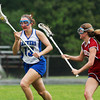 Danvers senior captain Katie McKenna, left, carries the ball downfield while being pursued by Gloucester's Melodie Orrell, on Tuesday afternoon. David Le/Staff Photo