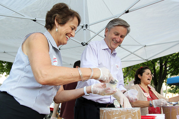 Congressman John Tierney and his wife Patrice, scoop ice cream for customers at the Ice Scream Bowl on Salem Common on Tuesday evening. David Le/Staff Photo