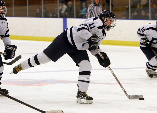 Peabody captain Tommy Burns (11) rips a shot on net against St. John's Prep. David Le/Salem News