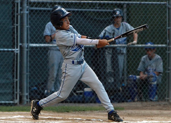 Danvers American leadoff hitter Jackson Leete tracks the flight of his game opening double off the center field fence against Saugus American in Sectionals action on Thursday evening. David Le/Staff Photo