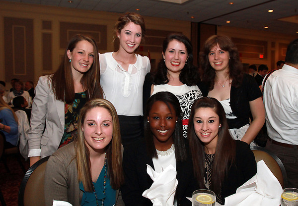Bishop Fenwick seniors clockwise from front left, Abby Curran, Rachel Steriti, Lauren Moulton, Charlotte Bond, Jennifer Collins, Nicole Bavaro, and Cheyenne Griffin, at the 44th Annual Honor Scholars Recognition Dinner at CoCo Key Hotel in Danvers on Tuesday evening. David Le/Staff Photo
