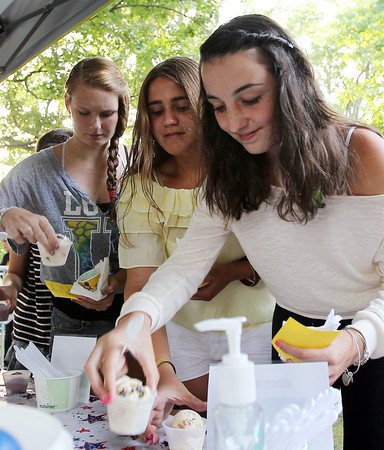 From left, Madison Roccio, Tori Kako, and Alex Kapantais, all 14 from Salem, pick out ice cream cups from the Down River Ice Scream table at the Ice Scream Bowl at Salem Common on Tuesday. David Le/Staff Photo