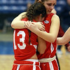 Masco seniors Taylor Evans, left, and Julia Simonetti, right, hug each other after losing to Andover in the D1 North Final on Saturday. David Le/Staff Photo