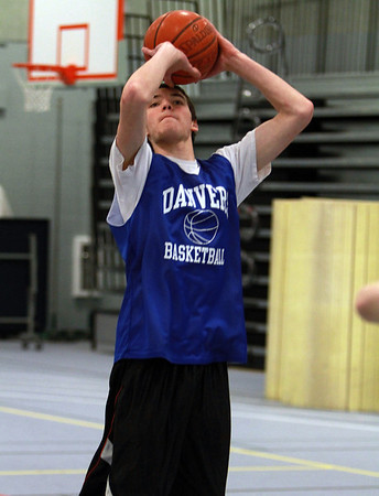 Danvers forward Dan Connors practices his jump shot at practice on Wednesday. David Le/Staff Photo