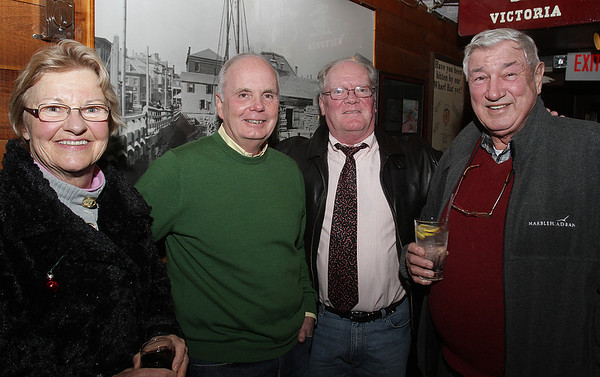 Salem: From left, Liz Mentuck, Bob St. Pierre, Bill Wholley, and Mike Mentuck at Salem's Annual Christmas Charity Fundraiser held at Victoria's Station on Tuesday evening. David Le/Salem News