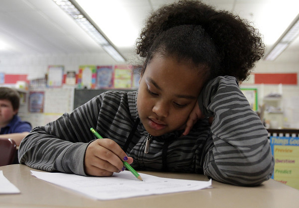 Bentley Elementary School 4th grader Corsia Dunwoody works on a placement excersize on Tuesday after school. David Le/Salem News