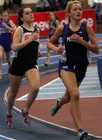 Beverly's Nicole Demars, left, and Peabody's Lauren Barrett compete in the girls mile race on Thursday afternoon at the Reggie Lewis Center in Roxbury. David Le/Salem News