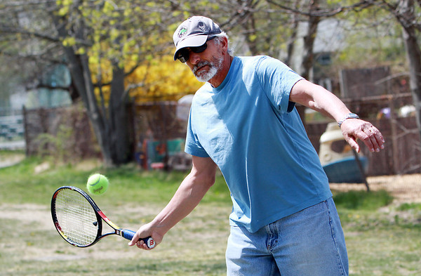 Dennis Urany, of Nahant plays tennis at the Seaside Courts in Marblehead on Friday afternoon. David Le/Staff Photo
