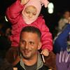 Sophia Balducci,l 3, of Salem sits on her father Frank Balducci's shoulders while waving to Santa Claus. David Le/Salem News
